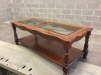 Glass topped mahogany style coffee table