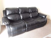 1x 3 seater and 1x 2 seater black reclining sofa