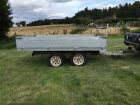 Twin axcel trailer for sale or swap. has tipping body but no pump for the ram.