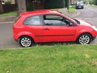 Red Ford Fiesta 3 Door Car