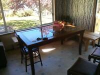 Wooden dining room table with glass inserts