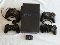 Playstation 2 plus 7 Games