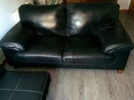 Faux leather sofa bed and 2 seater black leather