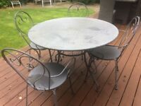 Metal patio table and four matching chairs