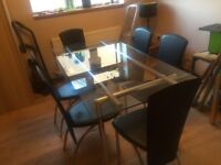Dining Table and Chairs - Glass Top Table and 6 Black Chairs
