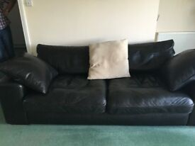 3 seater and 2 seater sofas with footstool in black leather very good condition