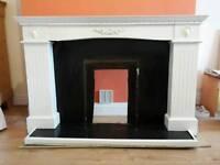 Fireplace surround, white wood.