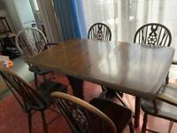 Dining room table and 6 chairs .