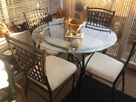 Smoked round glass table and 4 chairs