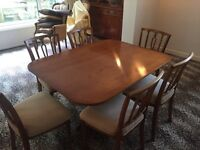 Beautiful Bevan Funnell dining table with 6 upholstered chairs.