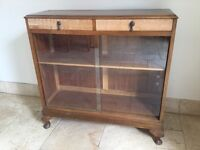 Two drawer floor standing brown wooden cabinet with sliding glass doors