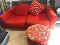 Red DFS two seater sofa and footstool