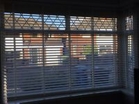 White wooden blinds with tapes