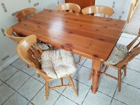 Solid wooden dining table and 6 chairs, excellent condition, small mark on table
