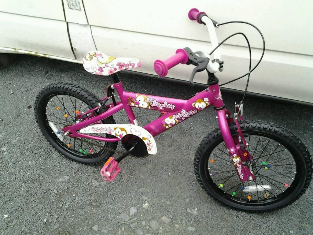 Girls 18 inch bike pink and white.