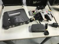 Nintendo n64 gaming console games station with controller and games