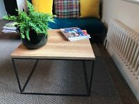Handmade industrial coffee table made of solid oak and welded metal