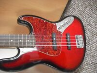 Squire by Fender bass guitar with Gator hard case for sale very good bass.
