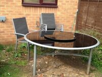 Black Glass Patio Table And Chairs