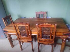 Solid oak dining table with wrought iron effect 6 matching chairs