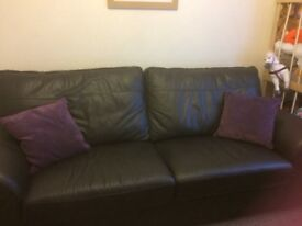 Large brown leather sofa and large storage footstool