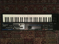 Roland Juno Gi moblie synth synthesizer with digital recorder.