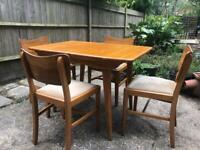 Mid-century extending table and 4x chairs. Teak veneer.