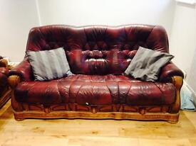 Two leather sofa's solid oak frames
