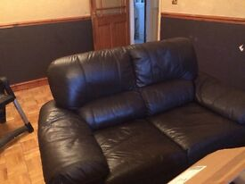 Two Brown Leather Sofa's. not matching. Buyer will need to collect but good condition