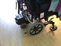 Detachable electric motor for wheelchairs