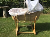 Palm Moses basket with adjustable hood and rocking stand.