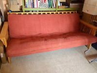 Red wooden double sofa bed