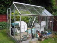 8 foot x 6 foot aluminium greenhouse partially dismantled for transportation