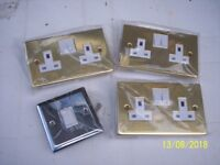 Three brass sockets and one chrome light switch