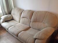 Cream fabric three-seater sofa and armchair