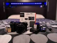 Sony a6000 w/ kit lens (16 - 50mm) 2 spare batteries with charging dock, 2 32gb sd cards.