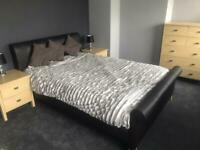 Double dark brown faux leather sleigh bed