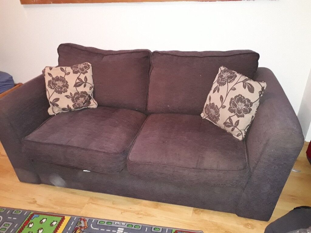 Brown sofa with matching puff