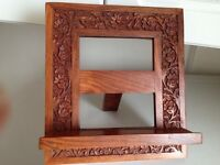 Beautifully carved wooden book display stand