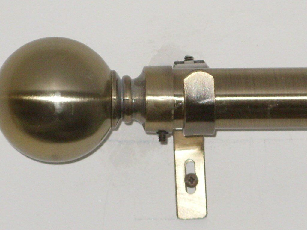 2 Curtain Poles in a Brushed Brass Finish