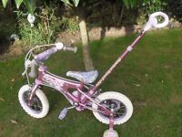 Girls Bike with stablisers and detachable adult handle which also steers....
