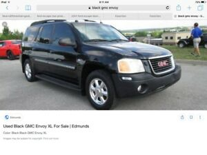 Stolen truck. Gmc envoy slt with dent in rear hatch door.