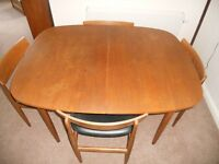 Extendable teak dining table and chairs