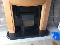 Granite fire surround and electric fire