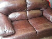 BROWN LEATHER 2-SEAT SOFA at Haven Housing Trust's charity shop