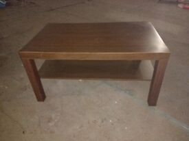 Dark brown coffee table with shelf