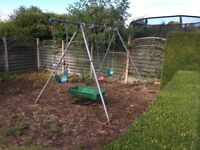 FREE - Outdoor metal-frame swing set.