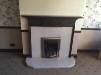Gas fire with marble surround and hearth, dark wood surround