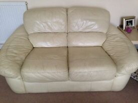 Free comfy sofa, ready to be collected. 2-seater, cream leather in reasonable condition.