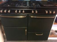 Free standing range cooker. Electric double oven fan assisted.Eight gas burners